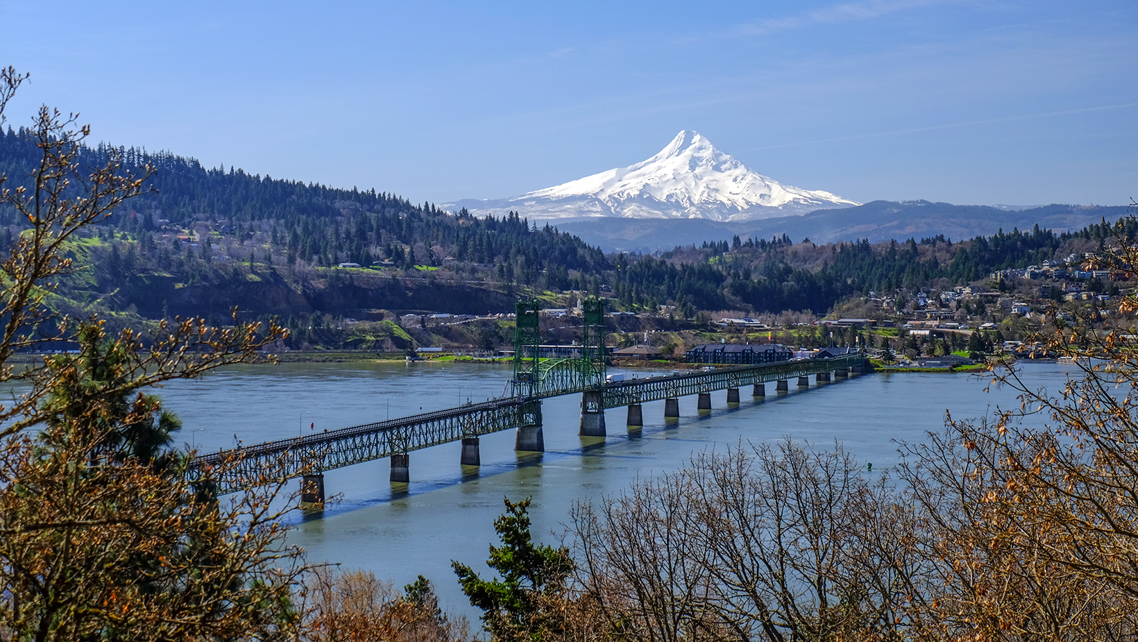 Gorgeous view of Mt. Hood as a backdrop to the Hood River Bridge, downtown Hood River and the Upper Valley