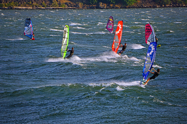 Windsurfers catch some wind as they zip across the choppy waters of the Columbia River