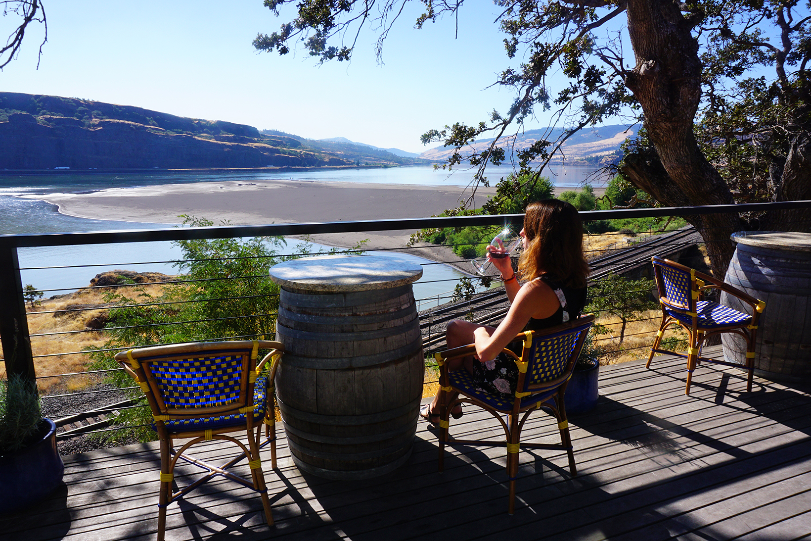 Drinking wine while enjoying a view of the Columbia River Gorge from eastern Washington