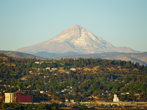 Summer view of Mosier with an almost snowless Mt. Hood in the background