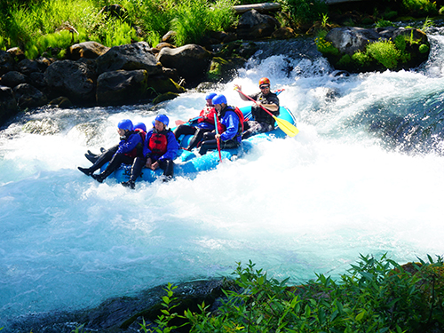 A guided group enjoys whitewater rafting on the rapids of the White Salmon River in the Mt. Adams Area
