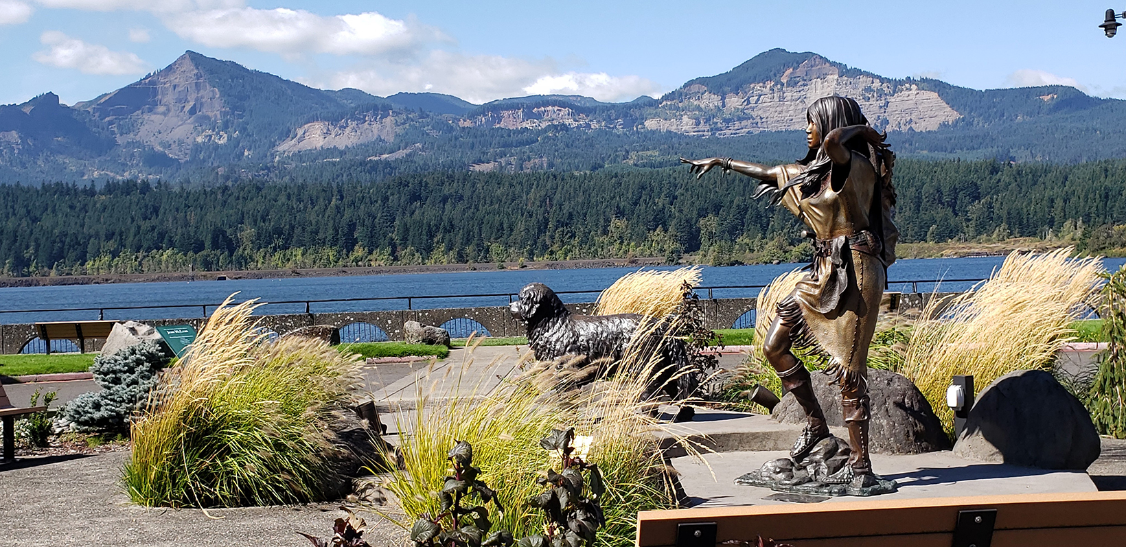 A statue of Sacagawea and her dog along the Cascade Locks waterfront