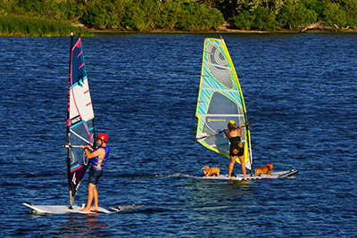 People learning how to windsurf, on calm water in the Gorge, in the early days of the sport